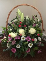Floral basket in cream and green lovingly hand made and delivered in darlington and the surrounding areas by Heavenly Scent Florist 33 bondgate darlington