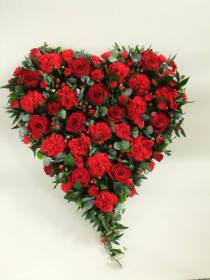 Beautiful red rose and red carnation and red berries trailing heart loving handmade by our expert florists and delivered in Darlington locally and the surrounding areas by heavenly scent florist.