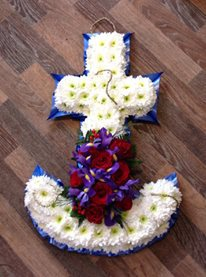 blue and white  anchor funeral tribute with blue ribbon and a red rose and purple iris courages  hand made by our florist in shop with fresh flowers we can offer local delivery to .darlington