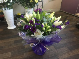 Cream and green roses and lily hand tied aqua packed bouquet local delivery florist darlington