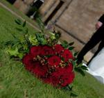 Bridal hand-tied bouquet of red grand prix roses and hype wedding flowers free local and surrounding areas delivery 33 bondgate darlington ricum berries