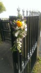Lemon, purple and aubergine church gate floral decoration with yellow roses, lizzy and sweet peas.  wedding flowers free local and surrounding areas delivery 33 bondgate darlington