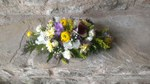 Wedding church decoration in lemon, purple, white and aubergine. with peonies, ranunculous, cala lillies, roses and lizzy.