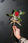 red rose with gypsophelia and gold ribbon wand for flowergirl or small bridesmaid.