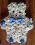 blue funeral tribute made lovingly by hand in our little shop with fresh flowers in 33 bondgate darlington local delivery and white fresh floral teddy bear