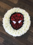 A spiderman posy pad fresh or artificial  floral teddy bear funeral tribute made lovingly by hand in our little shop with fresh flowers in 33 bondgate darlington local free delivery