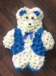 A classic blue and white teddy bear fresh or artificial  floral teddy bear funeral tribute made lovingly by hand in our little shop with fresh flowers in 33 bondgate darlington local free delivery