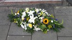 bright coffin spray sunflowers mixed yellow pruple casket tribute  floral funeral tribute heavenly scent florist darlington