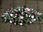 mixed pinks coffin spray roses lillies casket tribute  floral funeral tribute heavenly scent florist darlington