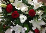 classic red and cream Lilly coffin spray  fresh  funeral flowers local and surrounding areas