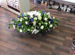 classic cream avalanch  and cream Lilly coffin say  fresh  funeral flowers free delivery local and surrounding areas casket tribute funeral flowers roses coffin florist designer hand made traditional
