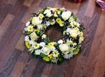 mixed wreath cream yellow and green  fresh  funeral flowers local and surrounding areas