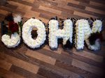 john black and white ribboned letters floral tribute made from fresh flower chrysanthemums loving made by our florist in 33 bondgate darlington  local deliveries