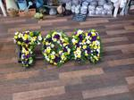 name tom in mixed fresh flowers white chrysanthemum  roses fresh flowers  floral funeral tribute Darlington designer floral tribute funeral sympathy tribute heavenly scent florist Darlington local free delivery