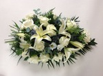 single ended spray classic simpler and elegant in cream roses lilies lisianthus eustoma and thistle. Loving handmade by our florists at heavenly scent on bondgate in darlington specialist in funeral and sympathy flowers