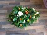 yellow green and cream single ended spra fresh  funeral flowers local and surrounding areas