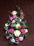 single ended tear drop coffin spray bright pink roses gypsophila and cream white  casket tribute  floral funeral tribute teardrop single ended heavenly scent florist darlington fresh  funeral flowers local and surrounding areas