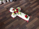 cross with red rose ,carnations gerbera seasonal traditinal foilage  courages  funeral tribute made lovingly by hand in our little shop with fresh flowers in 33 bondgate darlington free local delivery