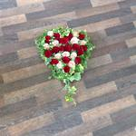 hearts open closed seasonal mixed rose ,carnations gerbera seasonal traditinal foilage  courages  funeral tribute made lovingly by hand in our little shop with fresh flowers in 33 bondgate darlington free local delivery
