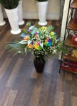 rain bow roses in a ceramic vase  bouquet hand tied  fresh flowers made by our florists in our family run business free local delivery and surrounding areas in darlington