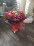 A stunning  mix of pink and cream roses and purple  bouquet hand tied  aqua pack fresh flowers made by our florists in our family run business free local delivery and surrounding areas in Darlington free local delivery family run friendly