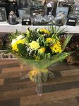A stunning  mix of yellow  and cream roses and purple  bouquet hand tied  aqua pack fresh flowers made by our florists in our family run business free local delivery and surrounding areas in Darlington free local delivery family run friendly