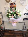 A stunning  mix of pink and cream Lillie and  roses and purple  bouquet hand tied  aqua pack fresh flowers made by our florists in our family run business free local delivery and surrounding areas in Darlington free local delivery family run friendly