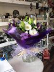 A stunning  mix of purple  and cream roses and purple  bouquet hand tied  aqua pack fresh flowers made by our florists in our family run business free local delivery and surrounding areas in Darlington free local delivery family run friendly